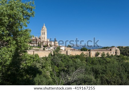 Views of the city of Segovia, Spain, from the city wall, with the Cathedral in the background - stock photo
