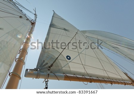 Views of the mast, sails and rigging on the private sail yacht. - stock photo