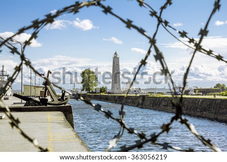 views of the Wooden lighthouse in kronstadt in sunny day .St. Petersburg. - stock photo