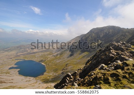views up and around Cadair Idris, Cader Idris or Penygader.  mountain known as three names in Gwynedd, Wales, which lies at the southern end of the Snowdonia National Park near the town of Dolgellau