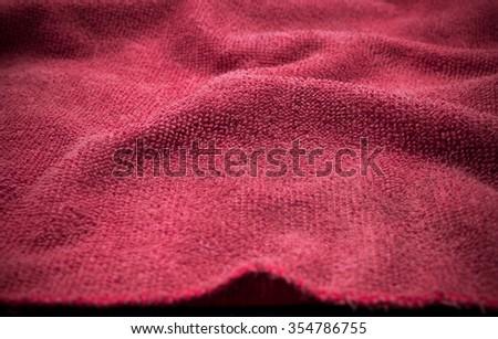Vignette cotton texture. Vignette towel texture. Towel texture. Luxury towel. Red towel background. Vignette textile texture. Cotton texture. Modern cotton texture. Carpet texture. Red carpet texture - stock photo
