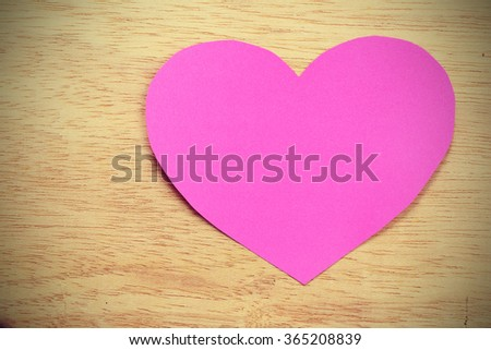 Vignette Style, Series of Valentines Card. Pink heart paper cut on wooden background. Image of Valentines day. Photoshop Vintage Effect. - stock photo