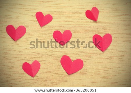 Vignette Style, Series of Valentines Card. Seven Red heart paper cut on wooden background. Image of Valentines day. Photoshop Vintage Effect. - stock photo