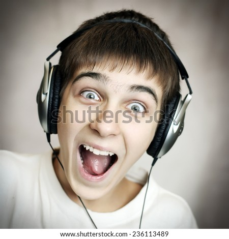 Vignetting Photo of Cheerful Teenager in Headphones - stock photo