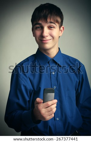 Vignetting Photo of Cheerful Teenager with Cellphone - stock photo