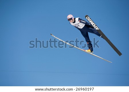 VIKERSUND, NORWAY - MARCH 15: Michael Neumayer of Germany competes in the FIS World Cup Ski Jumping Competition on March 15, 2009 in Norway.