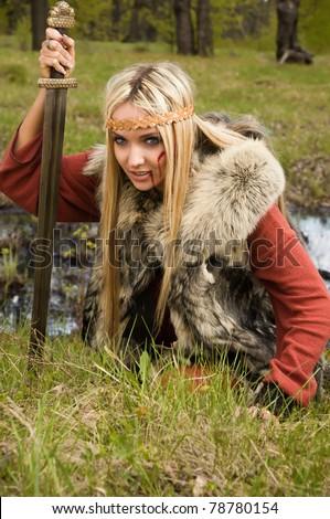 Viking girl warrior with sword - stock photo