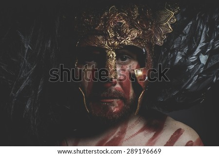 Viking, magician fighter with shield and helmet of gold and geometric shapes, fantasy - stock photo