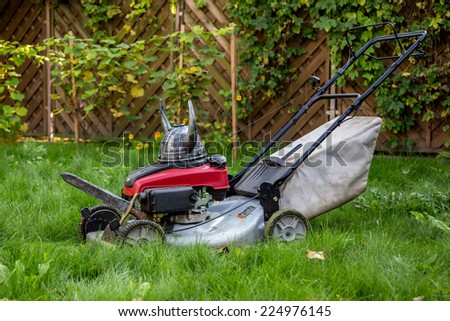 Viking mower attacking the grass in the garden - stock photo