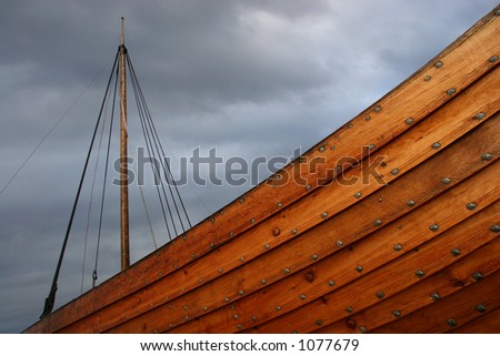 Viking ship caught in a stormy weather - stock photo