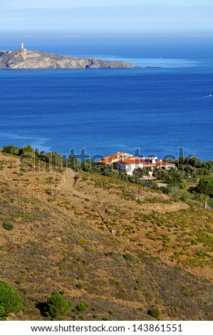 Villa above Mediterranean sea with the Cap Bear and its lighthouse in background, Roussillon, Pyrenees Orientales, Vermilion coast, France