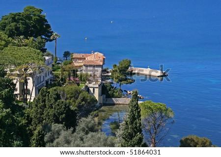Villa and blue sea in Saint Jean Cap Ferrat, France - stock photo