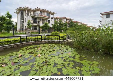 Villa houses and greening - stock photo