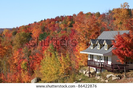 Villa in autumn, Mont Tremblant, Quebec, Canada - stock photo