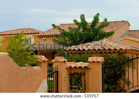 Villa in the typical color seen in the south of France. - stock photo