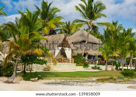Villa in Tropical Paradise. Dominican Republic, Seychelles, Caribbean, Mauritius, Philippines, Bahamas. Relaxing on remote Paradise beach. - stock photo