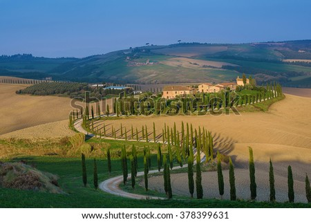 Villa in Tuscany with cypress road, idyllic seasonal nature landscape vintage hipster background - stock photo