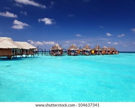 Villa on piles on water - stock photo