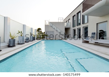 Villa with swimming pool and relaxation bed-5 - stock photo