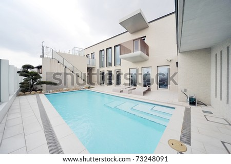 Villa with swimming pool and relaxation bed-3 - stock photo