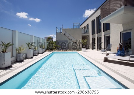 Villa with swimming pool with woman.
