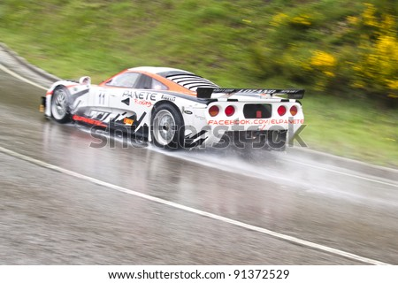 VILLABLINO, SPAIN - MAY 7: Spanish driver Raul Borreguero with Mosler MT900R, races in Subida a Leitariegos, on May 7, 2011 in Villablino, Spain