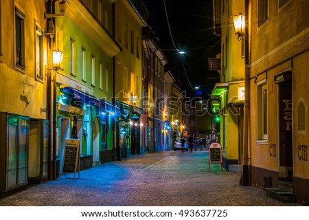 VILLACH, AUSTRIA, FEBRUARY 20, 2016: view of a narrow street full of bars and restaurants which is center of nightlife of the austrian city villach