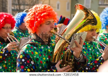 VILLACH, AUSTRIA - MARCH 5: Musicians took the street at the annual carnival procession held on Mar. 5, 2011 in Villach, Austria. Participants come from Austria, Italy and Slovenia.