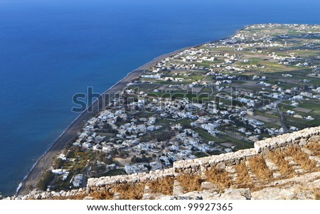 Village and beach of Perissa at Santorini island in the cyclades, Greece - stock photo