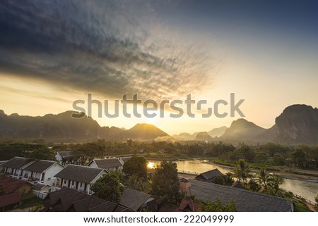 Village and mountain in Vang Vieng, Laos - stock photo