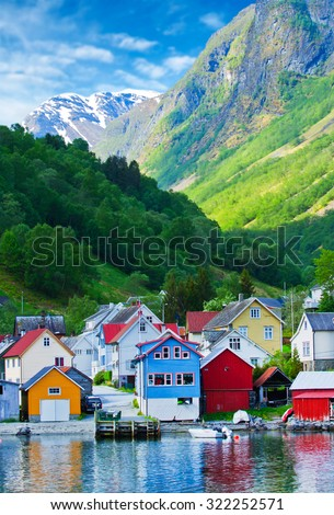 Village and Sea view on mountains in Geiranger fjord, Norway - stock photo