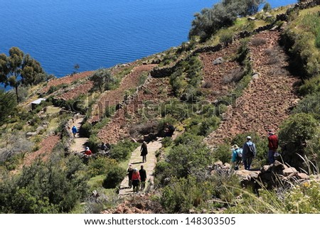 Village and Terrace Farming at Island Taquile Lake Titicaca - stock photo