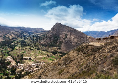 village and the ancient fort in a mountain valley - stock photo