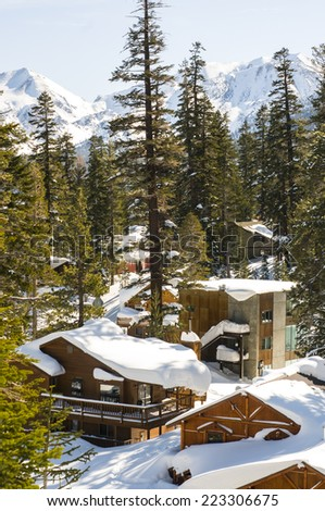 Village cabins of a California mountain town during winter - stock photo