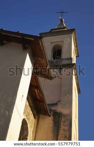 village church, Entracque, Cuneo, Piemonte, Italy. The Italian Maratime Alps are in the background.
