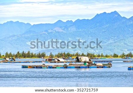 Village fishermen raft on the bay with the connector on raft raft was floating homes for resident fishermen when fishing in the bay, very beautiful and idyllic - stock photo