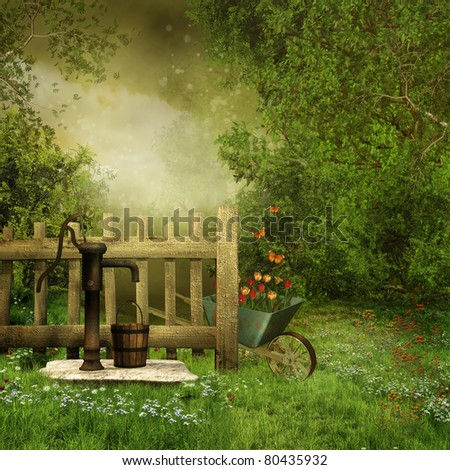 Village garden with an old water pump - stock photo
