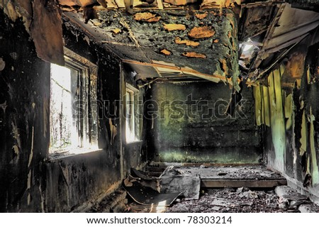 Village house after the fire in hdr - stock photo