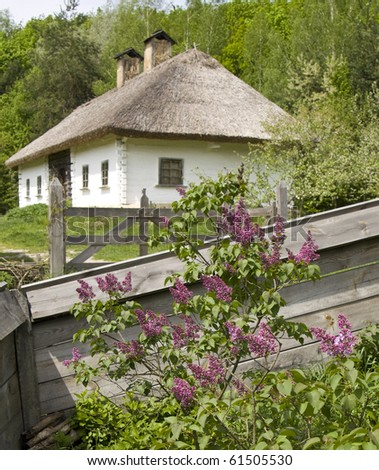 Village house, recorded in outdoors museum of national architecture in Pirogovo, near Kiev, capital of Ukraine. - stock photo