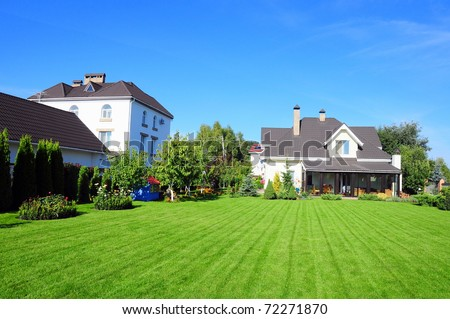 village houses and their garden - stock photo