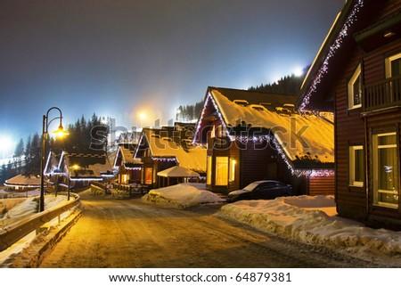 Village in mountains. Night landscape - stock photo