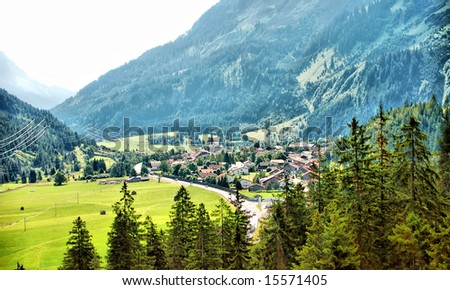 village in the alp mountains - stock photo
