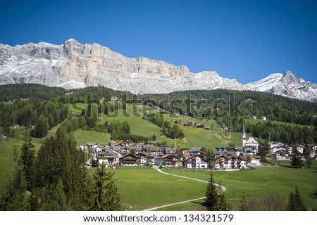 Village in the Dolomite mountains, Tyrolean region of northern Italy - stock photo