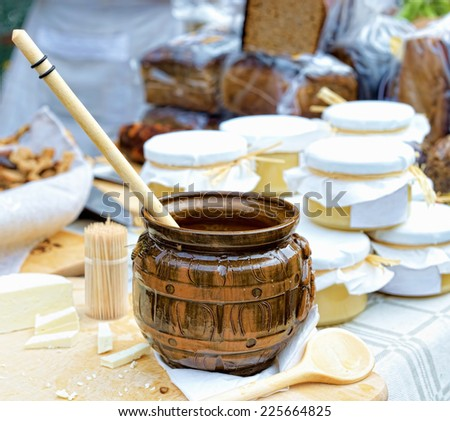 Village market scene with honey, cheese, and bread of artisan production - stock photo