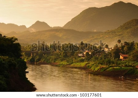 village near by river and hill, luang prabang city, laos - stock photo