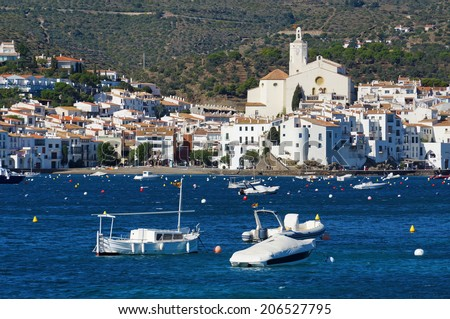 village of Cadaques on the Mediterranean coast with boats on mooring buoys in foreground, Catalonia, Costa Brava, Spain - stock photo