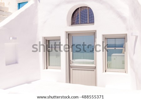 Village of Oia in Santorini,Traditional houses and churches with blue domes
