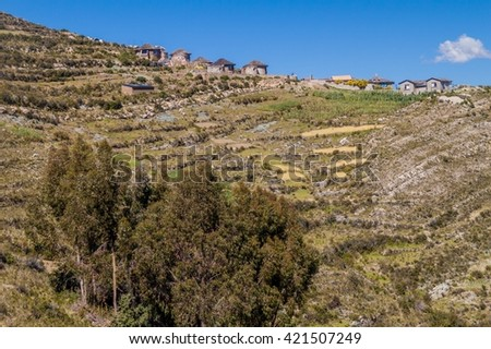 Village on Isla del Sol (Island of the Sun) in Titicaca lake, Bolivia - stock photo