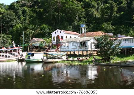 Village on the Amazon - stock photo
