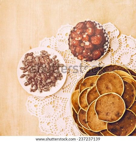 Village pancakes on wooden background on patterned napkins  - stock photo
